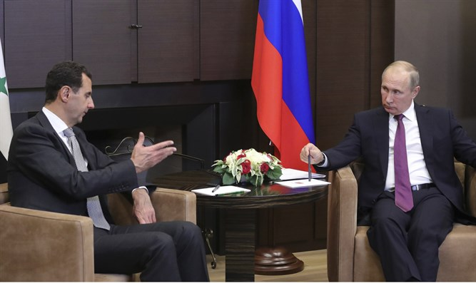 Putin taciturn: Meeting with Assad (L)