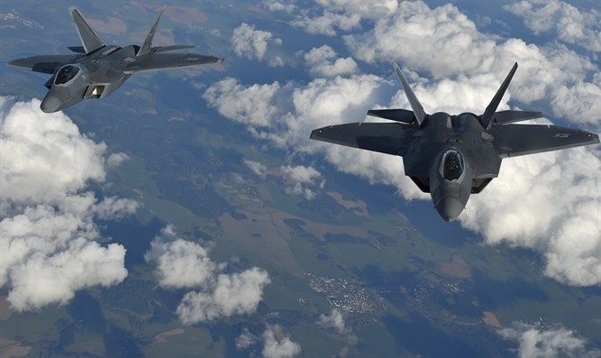 Two U.S. F-22 Raptor stealth fighters