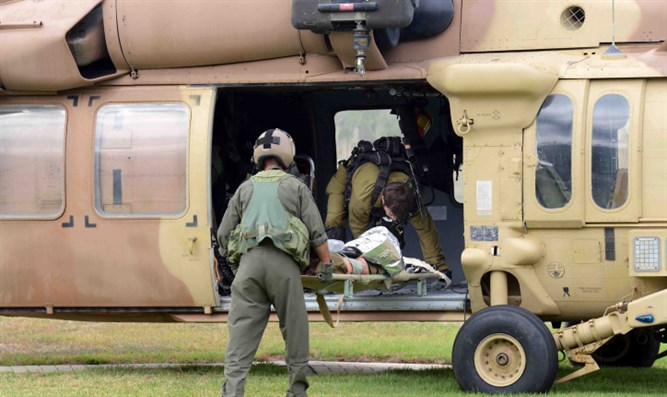 Evacuating injured soldier (archive)