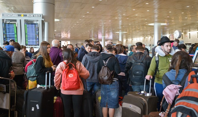 Passengers wait in line at Ben Gurion Airport