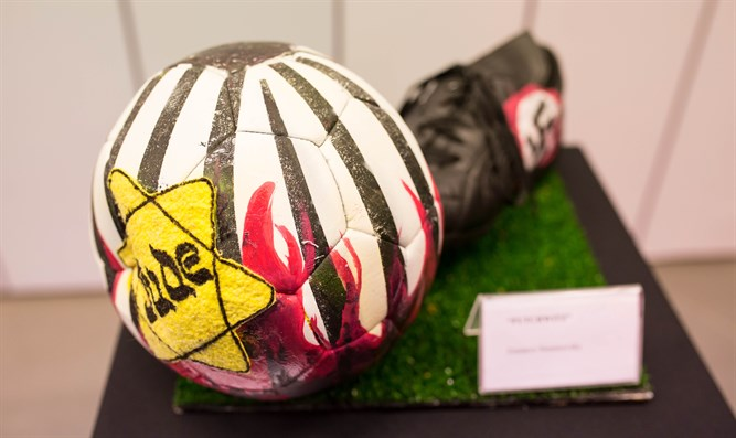 The exhibition at River Plate's museum includes six illustrated soccer balls.