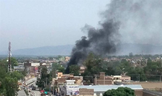 Smoke rises from site of blast and gunbattle, Jalalabad, Afghanistan