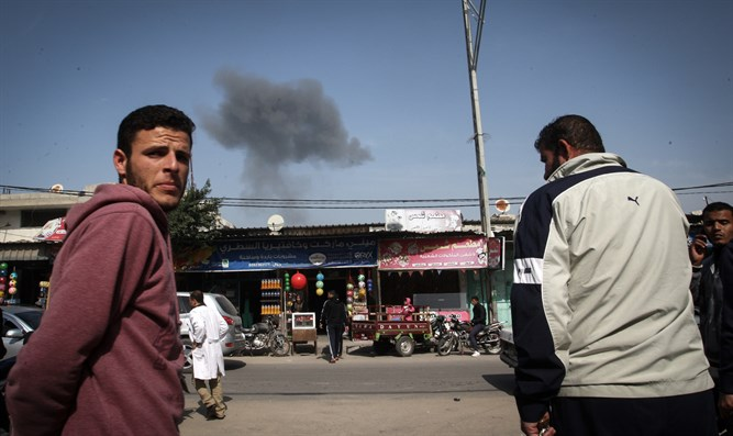 Gazans watch smoke rise from building in Rafah