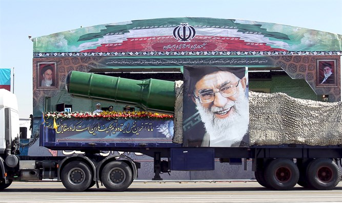 Military truck carrying a missile and a picture of Iran's Supreme Leader Ayatoll