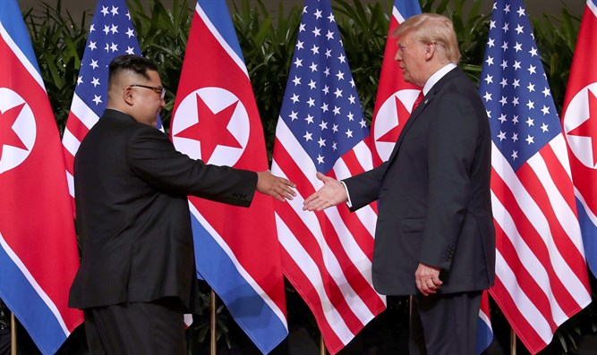 Kim Jong Un and Donald Trump shake hands