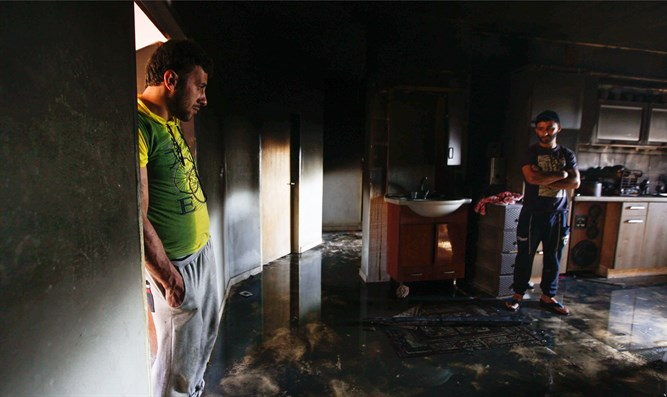 Home that was torched in Duma