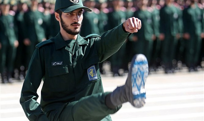 Iranian Officer of Revolutionary Guards, with Israel flag drawn on his boots