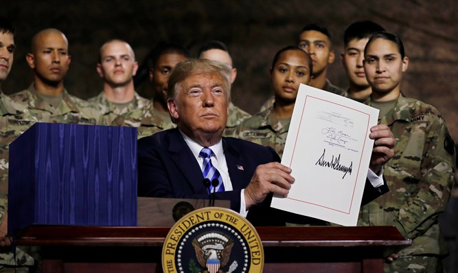 Trump holds up National Defense Authorization Act after signing it