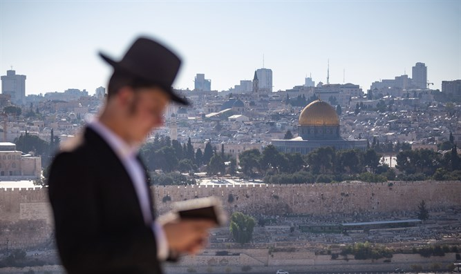 Jew prays on Mount of Olives facing Temple Mount