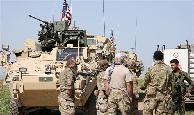 US troops deployed in northeastern Syria meet with Kurdish fighters