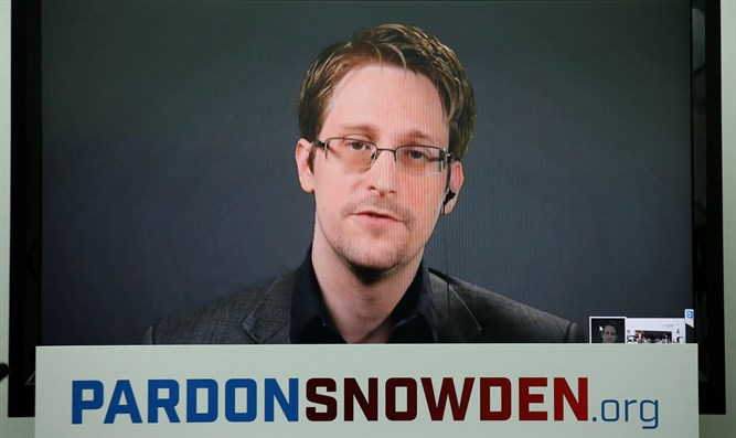 Edward Snowden speaks via video link during news conference in New York