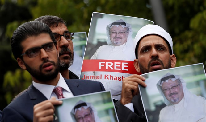 Friends of Saudi journalist Jamal Khashoggi hold his pictures during protest
