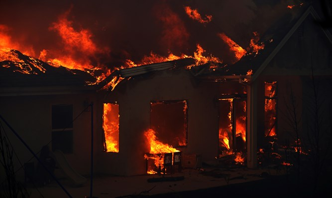 Building engulfed in flames during the Camp Fire in Paradise, California