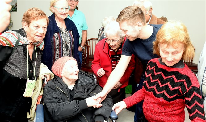 Yair Netanyahu meets Holocaust survivors