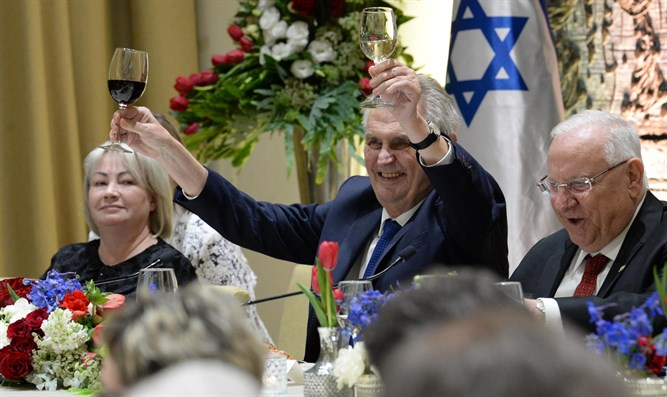 President Zeman raises two glasses in a toast