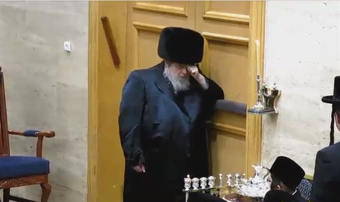 Belzer Rebbe lighting Hanukkah candles