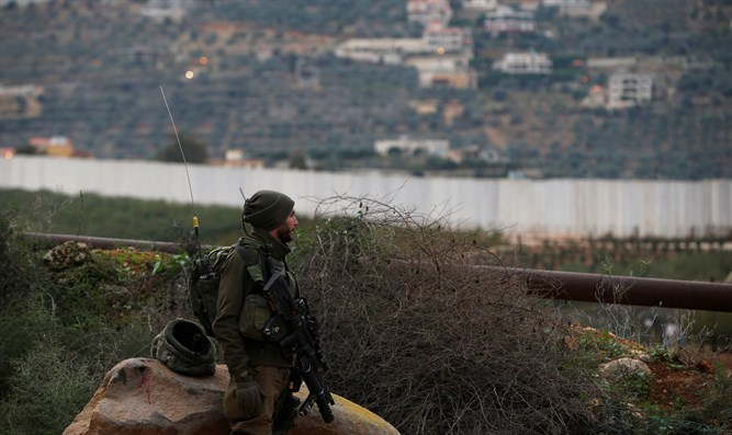 Israeli soldier guards near border with Lebanon