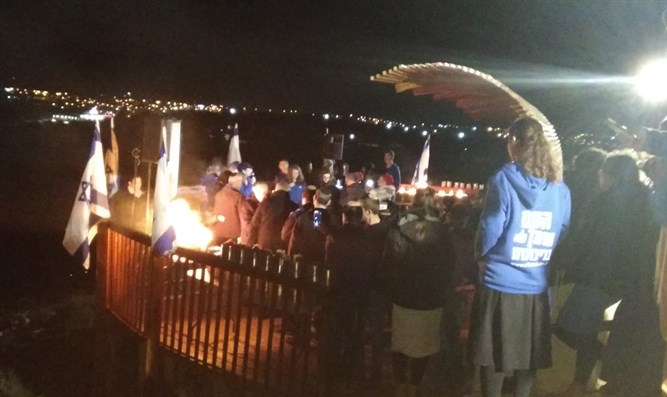 candle lighting ceremony at Ari Fuld lookout