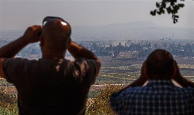 Smoke rises near Kuneitra Crossing seen from Golan Heights