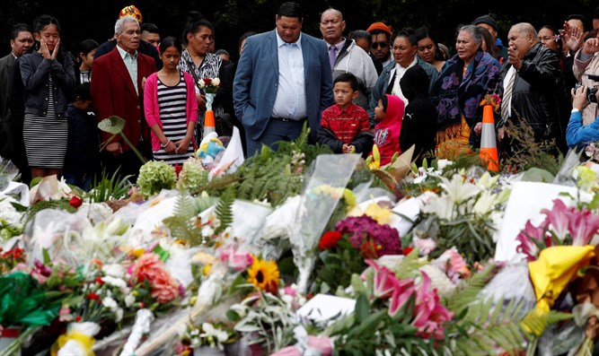 Mourners at a memorial for victims of the New Zealand shootings