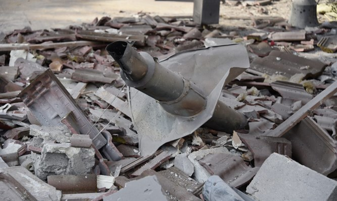 Remains of rocket in rubble of destroyed home