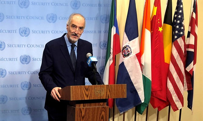 Syrian Ambassador to UN Bashar Jaafari speaks to reporters at UN headquarters