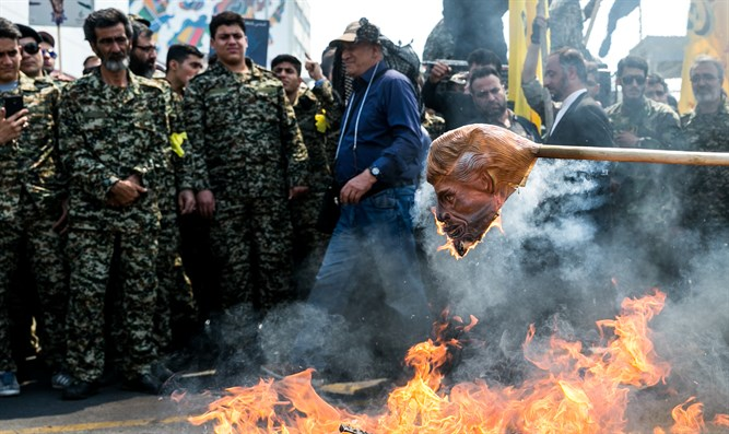 Demonstrators in Iran burn mask of Donald Trump on Al Quds Day