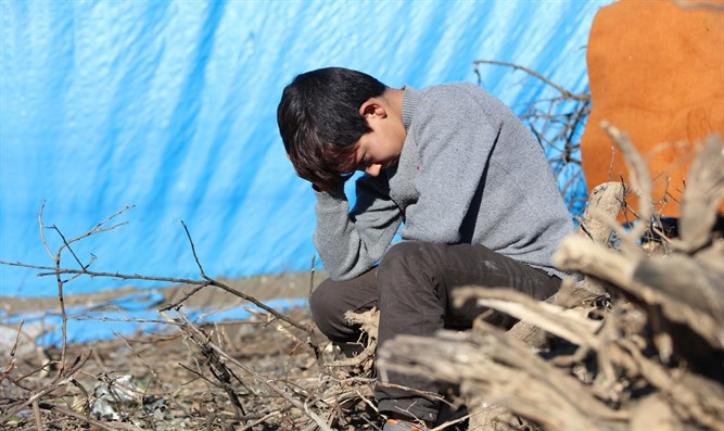 Boy in Syrian refugee camp