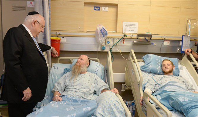 Rivlin with Rabbi Eitan Shnerb and his son Dvir