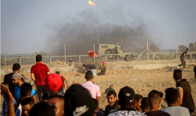 Protesters clash with Israeli forces on Gaza-Israel border