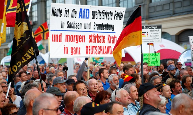 Supporters of the anti-Islam movement PEGIDA gather during a demonstration