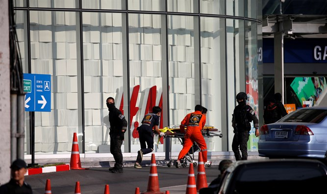 Rescue workers enter Thailand shopping mall following shooting attack