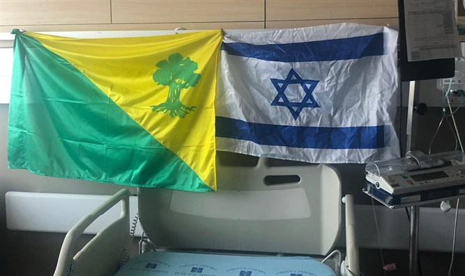 Israeli and Golani unit flags in the soldier's hospital room