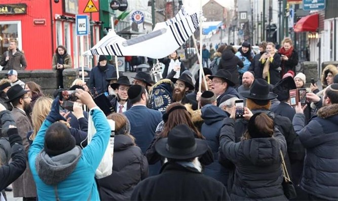 Members of the Jewish community of Reykjavik bringing its new Torah scroll to th
