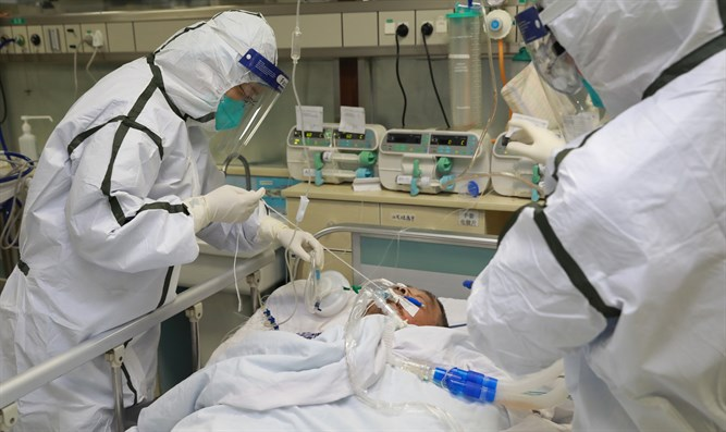 Medical staff in protective suits treat patient in Wuhan