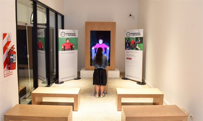 A view inside the Holocaust survivor hologram exhibition with the testimonies